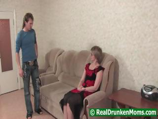 Drunk mom with a younger chap starts to fuck and then passes out