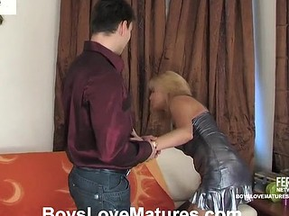 Seductive older honey flirting with a guy in advance of bending over on the sofa